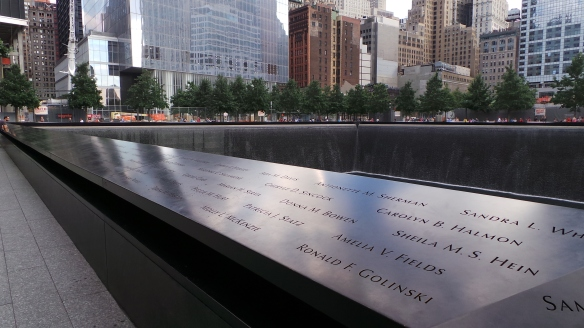 2. The names of the 911 Fallen Heroes inscribed around the twin memorial pools