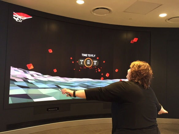 Robyn Wright testing out the interactive focal wall at the New Verizon Boston Destination store image by Katie Shea Design VZWBuzz